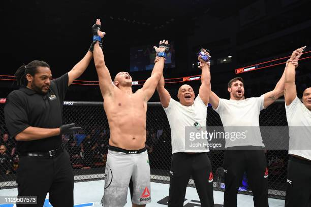 Junior Dos Santos of Brazil celebrates after defeating Derrick Lewis in their heavyweight bout during the UFC Fight Night event at Intrust Bank Arena...