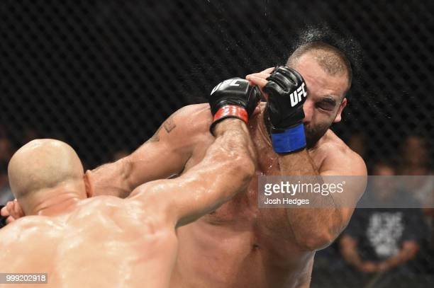 Junior Dos Santos of Brazil punches Blagoy Ivanov in their heavyweight fight during the UFC Fight Night event inside CenturyLink Arena on July 14...