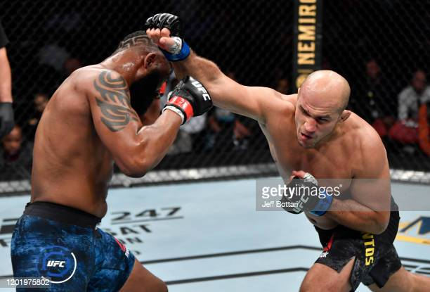 Junior Dos Santos of Brazil punches Curtis Blaydes in their heavyweight fight during the UFC Fight Night event at PNC Arena on January 25 2020 in...