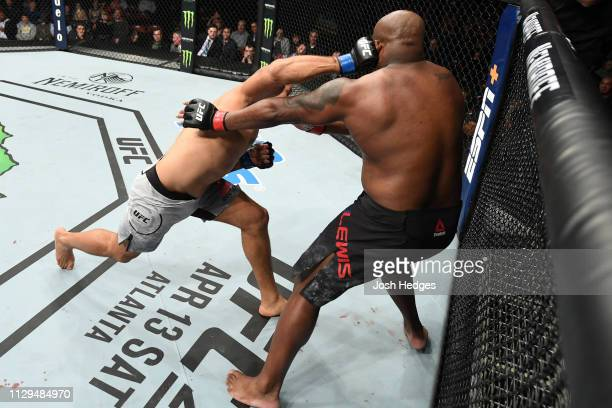 Junior Dos Santos of Brazil punches Derrick Lewis in their heavyweight bout during the UFC Fight Night event at Intrust Bank Arena on March 9 2019 in...