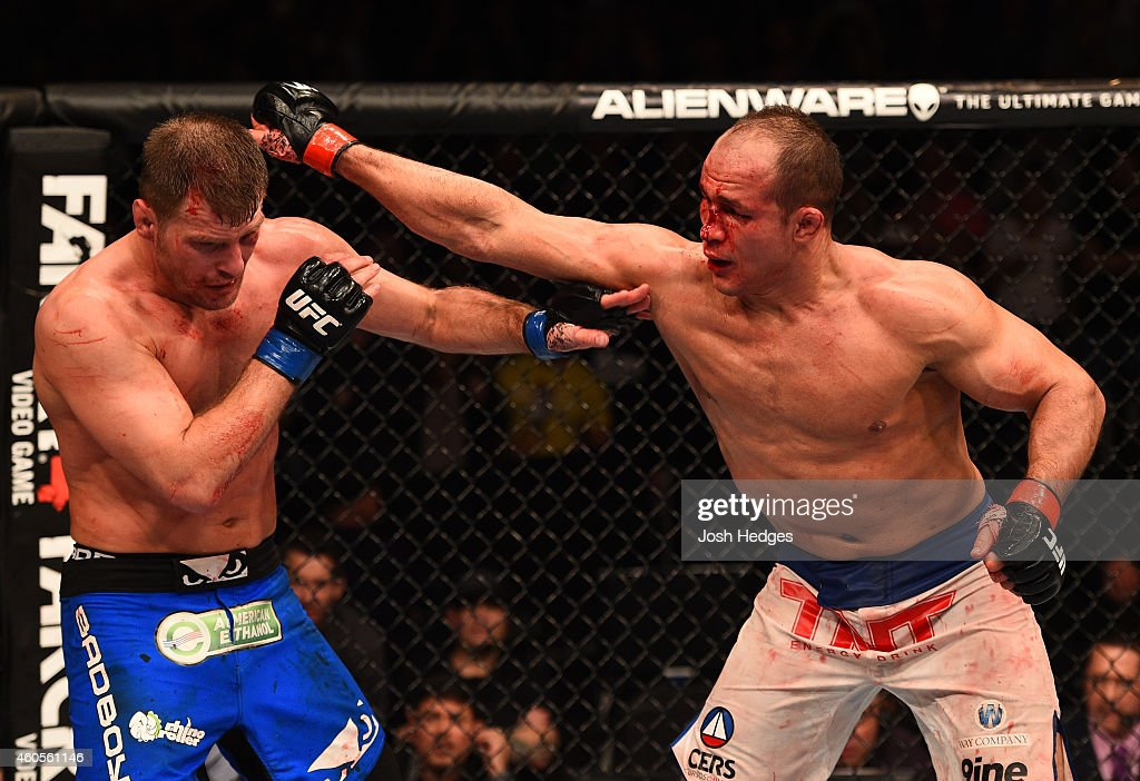 Junior Dos Santos of Brazil punches Stipe Miocic in their heavyweight fight during the UFC Fight Night event at the U.S. Airways Center on December 13, 2014 in Phoenix, Arizona.