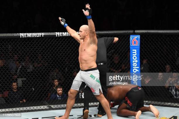 Junior Dos Santos of Brazil reacts after defeating Derrick Lewis in their heavyweight bout during the UFC Fight Night event at Intrust Bank Arena on...