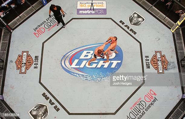 Junior Dos Santos punches Cain Velasquez in their UFC heavyweight championship bout at the Toyota Center on October 19 2013 in Houston Texas Cain...