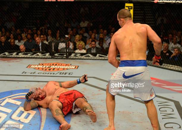 Junior dos Santos reacts to knocking down Mark Hunt in their heavyweight bout during UFC 160 at the MGM Grand Garden Arena on May 25 2013 in Las...