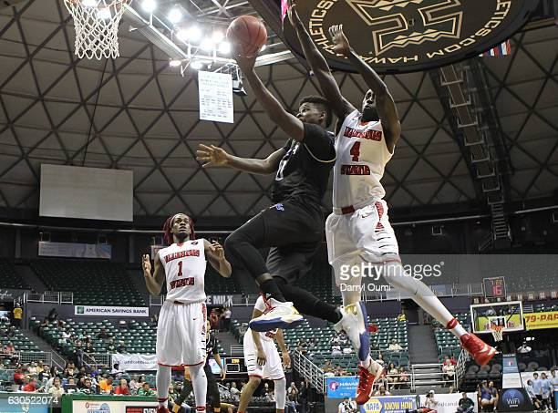 Junior Etou of the Tulsa Golden Hurricane gets around Daouda Ndiaye of the Illinois State Redbirds and lays the ball in during the second half of the...