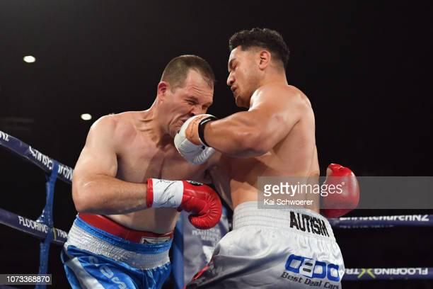 Junior Fa punches Rogelio Omar Rossi during the WBO Interim Oriental Heavyweight title fight between Junior Fa and Rogelio Omar Rossi at Horncastle...