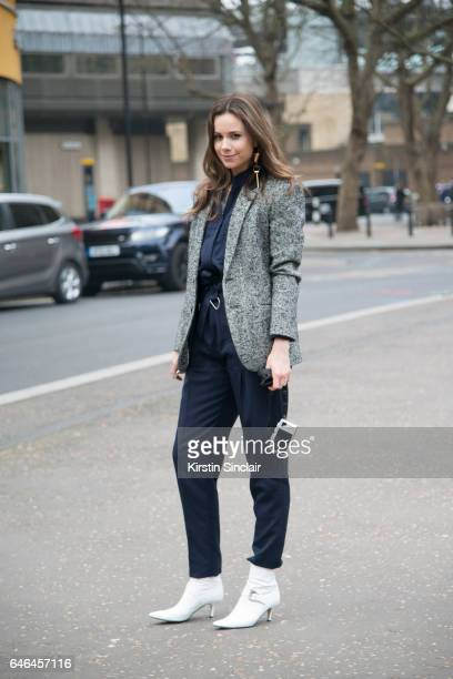 Junior fashion editor at Harpers Bazaar Florrie Thomas wears a Tibi jacket Victoria Beckham jumpsuit Dorateymur boots and Louis Vuitton earrings on...