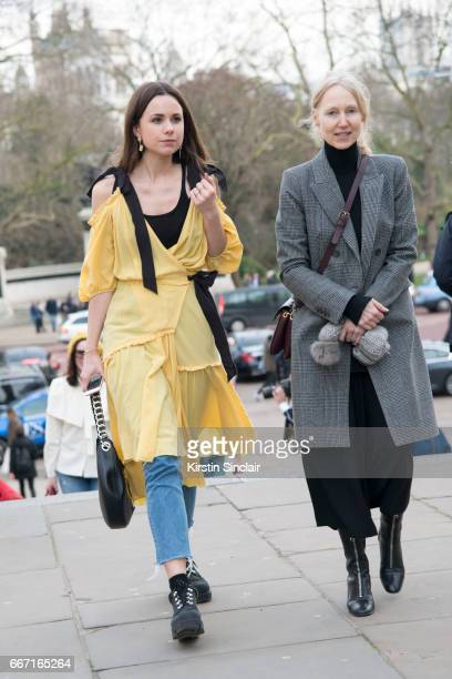 Junior Fashion Editor at Harper's Bazaar Florrie Thomas wears an Anna Mason dress HM jeans Loewe bag and Acne trainers with a guest on day 4 of...