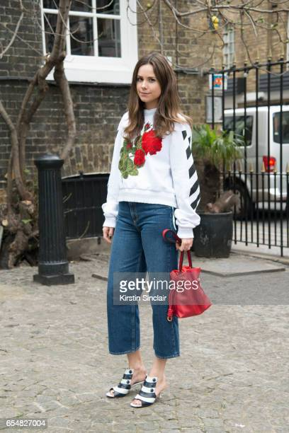 Junior fashion editor at Harpers Bazaar Uk Florrie Thomas wears MIH jeans Off White sweater Manolo Blahnik shoes and Loewe bag on day 5 of London...