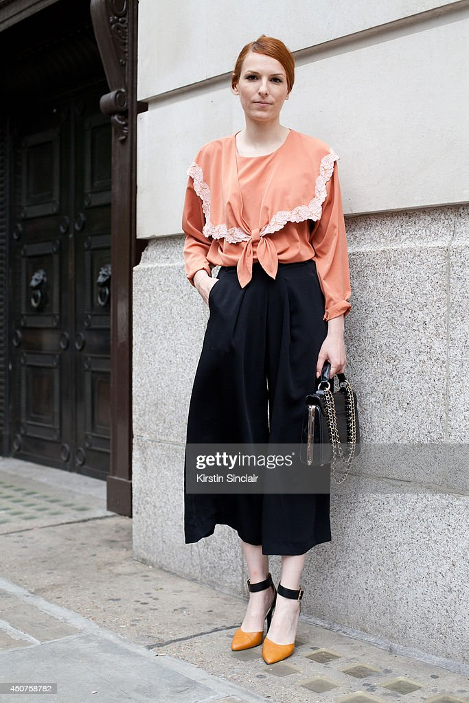 Junior Fashion Editor Marianna Frannais wears a vintage top and shoes, Cos trousers and Zara bag on day 1 of London Collections: Men on June 15, 2014 in London, England.