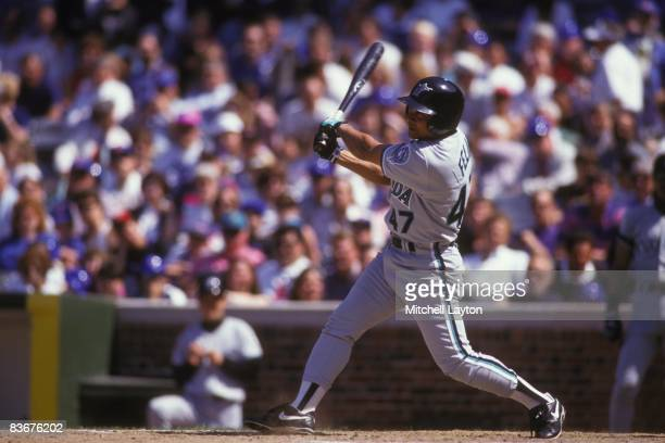 Junior Felix of the Florida Marlins bats during a baseball game against the Chicago Cubs on June 1 1993 at Wrigley Field in Chicago Illinois