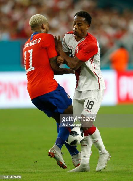 Junior Fernandes of Chile and André Carrillo of Peru battle for the ball during an International friendly match on October 12 2018 at Hard Rock...