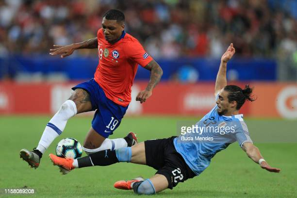 Junior Fernandes of Chile competes for the ball with Martin Caceres of Uruguay during the Copa America Brazil 2019 group C match between Chile and...