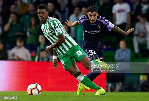 Junior Firpo of Betis competes for the ball with Leo Suarez of Valladolid during the La Liga match between Real Betis Balompie and Real Valladolid CF...