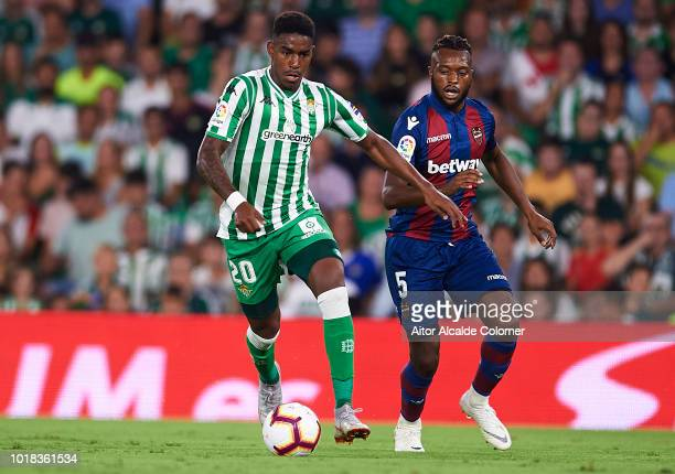 Junior Firpo of Real Betis Balompie being followed by Cheik Doukoure of Levante UD during the La Liga match between Real Betis Balompie and Levante...