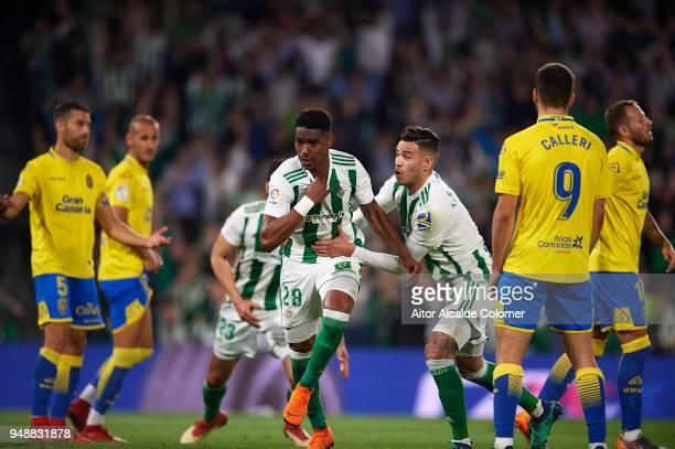 Junior Firpo of Real Betis Balompie celebrates after scoring with his team mate Arnaldo Antonio Sanabria of Real Betis Balompie during the La Liga...