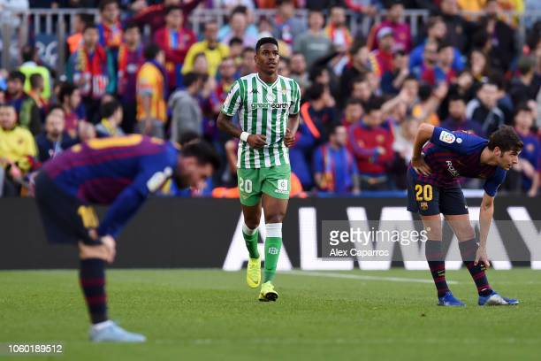Junior Firpo of Real Betis celebrates after scoring his team's first goal during the La Liga match between FC Barcelona and Real Betis Balompie at...