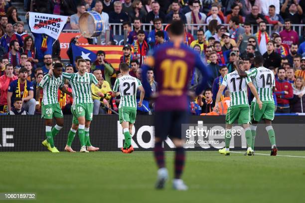 Junior Firpo of Real Betis celebrates after scoring his team's first goal with team mates during the La Liga match between FC Barcelona and Real...
