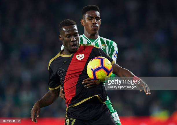 Junior Firpo of Real Betis competes for the ball with Advincula of Rayo Vallecano during the La Liga match between Real Betis Balompie and Rayo...