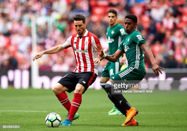 Junior Firpo of Real Betis competes for the ball with Aritz Aduriz of Athletic Club during the La Liga match between Athletic Club Bilbao and Real...