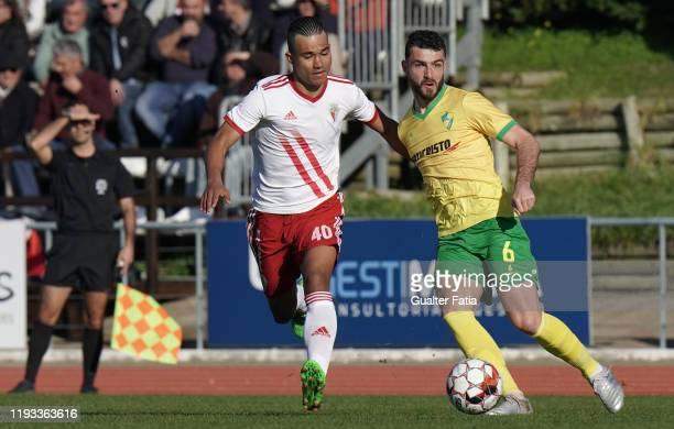 Junior Franco of CD Mafra with Gustavo Tocantins of UD Vilafranquense in action during the Liga Pro match between CD Mafra and UD Vilafranquense at...