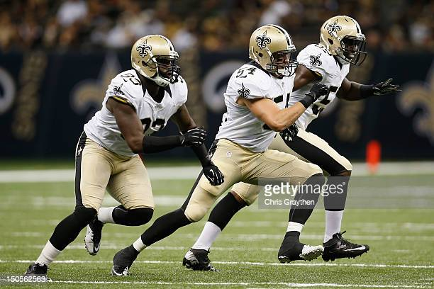 Junior Galette and Will Herring of the New Orleans Saints during the game against the Jacksonville Jaguars and at the MercedesBenz Superdome on...