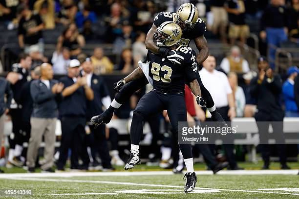 Junior Galette of the New Orleans Saints celebrates a sack with Parys Haralson during the third quarter of a game against the Baltimore Ravens at the...