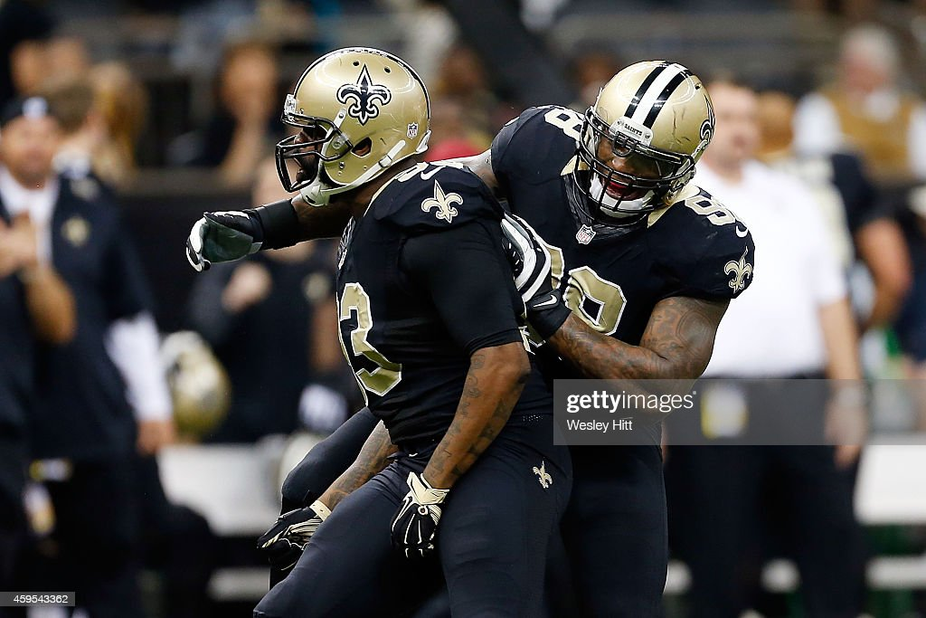 Junior Galette #93 of the New Orleans Saints celebrates a sack with Parys Haralson #98 during the third quarter of a game against the Baltimore Ravens at the Mercedes-Benz Superdome on November 24, 2014 in New Orleans, Louisiana.