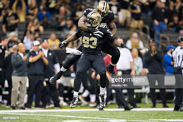 Junior Galette of the New Orleans Saints celebrates a sack with Parys Haralson during the third quarter of a game against the Baltimore Ravens at...