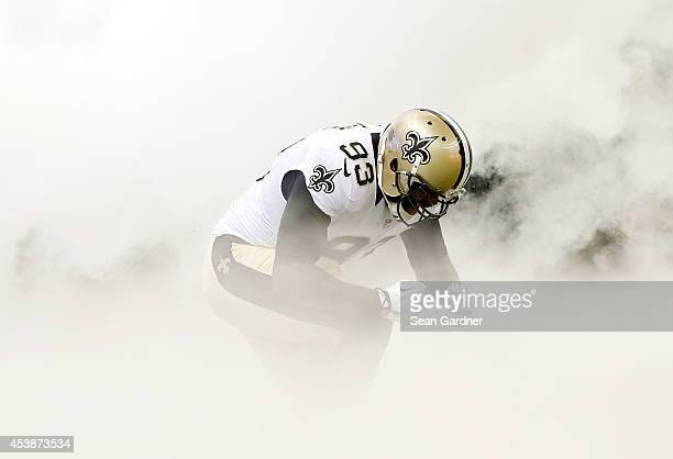 Junior Galette of the New Orleans Saints enters the field prior to a preseason game against the Tennessee Titans at the MercedesBenz Superdome on...