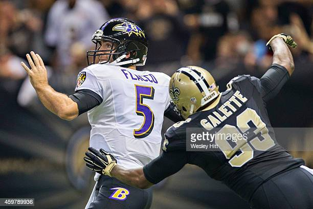 Junior Galette of the New Orleans Saints hits Joe Flacco of the Baltimore Ravens while throwing a pass in the first quarter at MercedesBenz Superdome...
