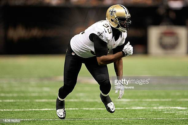 Junior Galette of the New Orleans Saints jumps from the line against the Miami Dolphins during a game at the MercedesBenz Superdome on September 30...