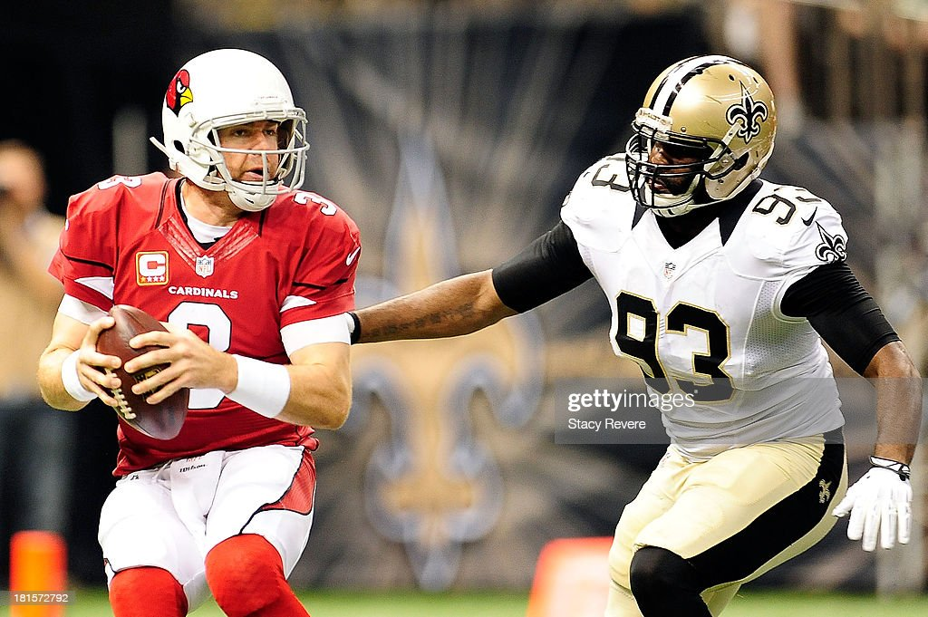 Junior Galette #93 of the New Orleans Saints pressures Carson Palmer #3 of the Arizona Cardinals during a game at the Mercedes-Benz Superdome on September 22, 2013 in New Orleans, Louisiana. The Saints defeated the Cardinals 31-7.