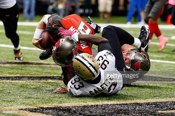Junior Galette of the New Orleans Saints sacks Mike Glennon of the Tampa Bay Buccaneers for a safety during the fourth quarter of a game at the...