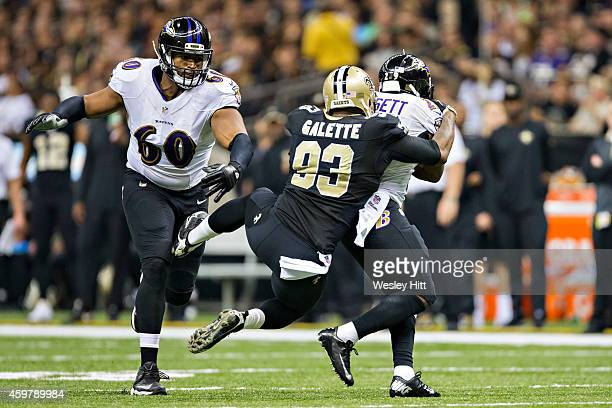 Junior Galette of the New Orleans Saints tackles Justin Forsett of the Baltimore Ravens in the second quarter at MercedesBenz Superdome on November...