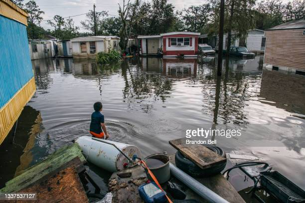 """Junior Godoy stands in front of his grandfather's house after it was flooded during Hurricane Ida on August 31, 2021 in Barataria, Louisiana. """"I've..."""