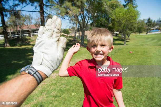 junior golfer high five - junior level stock pictures, royalty-free photos & images