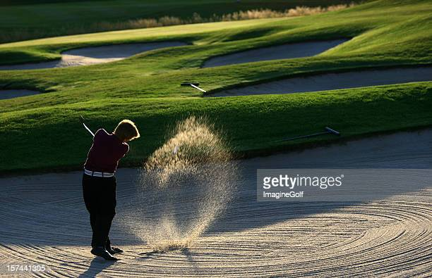 Junior Golfer Hitting Bunker Shot