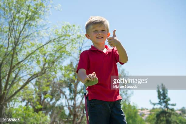 junior golfer thumbs up - junior level stock pictures, royalty-free photos & images