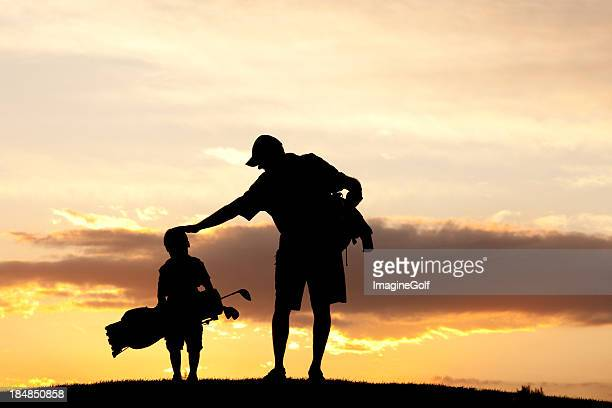 Junior Golfer With Father