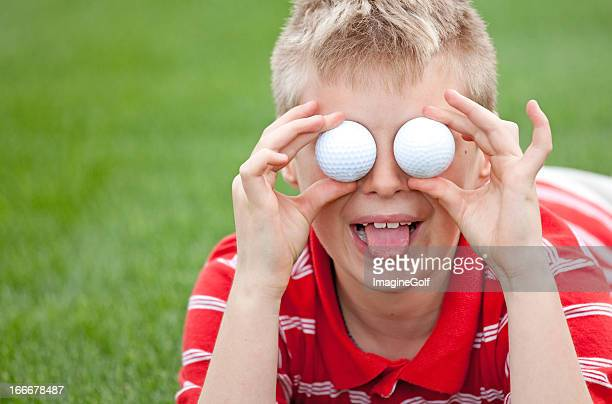 junior golfer with golf balls for eyes - bug eyes stock photos and pictures