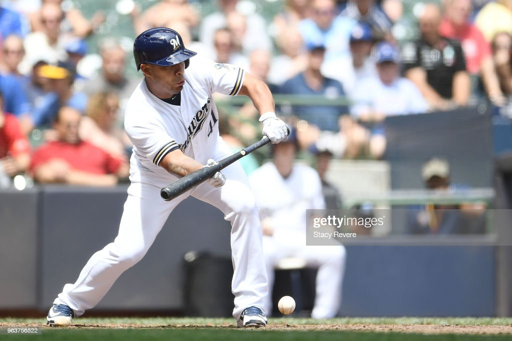 Junior Guerra #41 of the Milwaukee Brewers bunts against the St. Louis Cardinals during the fifth inning of a game at Miller Park on May 30, 2018 in Milwaukee, Wisconsin.