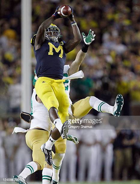 Junior Hemingway of the Michigan Wolverines catches a fourth quarter pass while playing the Notre Dame Fighting Irish at Michigan Stadium on...