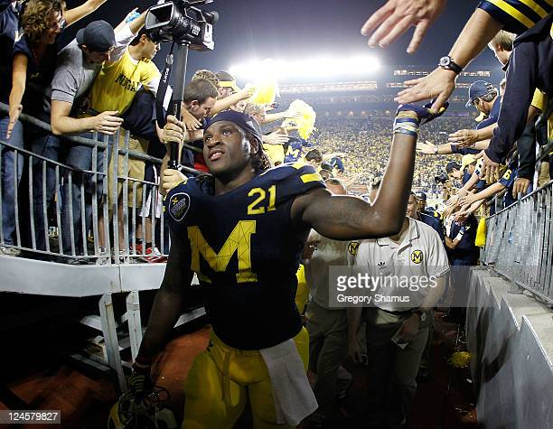 Junior Hemingway of the Michigan Wolverines celebrate with fans while leaving the field after beating the Notre Dame Fighting Irish 3531 at Michigan...