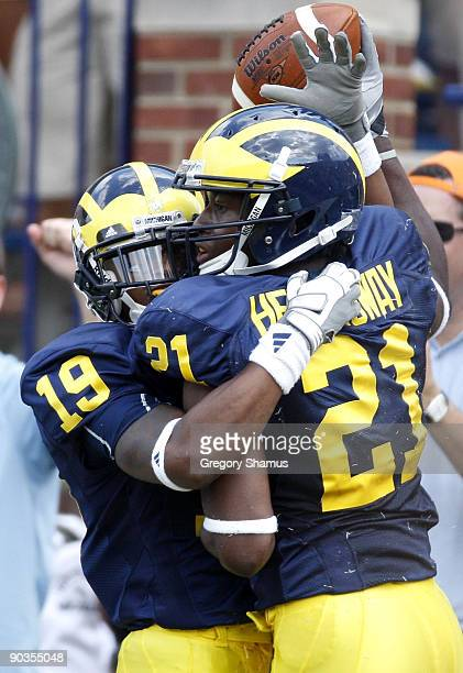 Junior Hemingway of the Michigan Wolverines celebrates a first quarter touchdown with Kelvin Grady while playing the Western Michigan Broncos on...