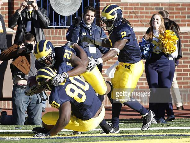Junior Hemingway of the Michigan Wolverines celebrates a two point conversion in triple overtime while playing the Illinios Fighting Illini with...