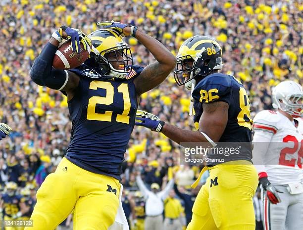 Junior Hemingway of the Michigan Wolverines celebrates his first quarter touchdown with Kevin Koger while playing the Ohio State Buckeyes at Michigan...
