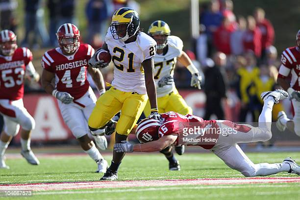 Junior Hemingway of the Michigan Wolverines eludes a tackle from Matt Ernest of the Indiana Hoosiers at Memorial Stadium on October 2 2010 in...