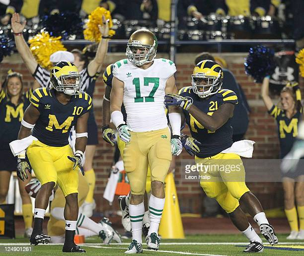Junior Hemingway of the Univerity of Michigan scores on a 43 yard touchdown pass from Denard Robinson in the second quarter during the game against...