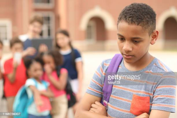 junior high age boy being bullied at school. - cruel stock pictures, royalty-free photos & images